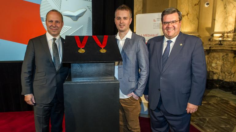 President of the Chamber of commerce Michel Leblanc, Industrial designer Jacques Desbiens and Mayor of Montreal Denis Coderre unveiling the Ordre de Montréal medal, at City Hall, on May 17, 2016