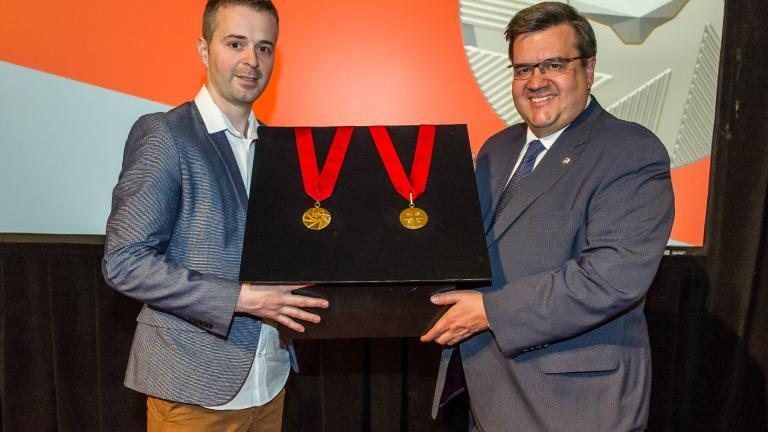 Mayor of Montreal Denis Coderre and Industrial designer Jacques Desbiens unveiling the Ordre de Montréal medal at City Hall on May 27, 2016